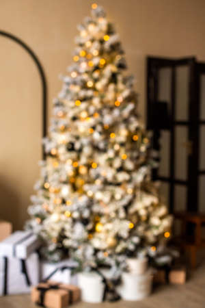 defocus. Christmas tree with gifts in a bright living room. white, black, yellow. blogging content