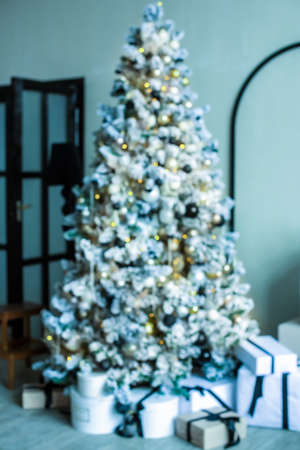 defocus. Christmas tree with gifts in a bright living room. white, blue, yellow. blogging content