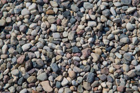 Small sea stones, gravel background. Textures