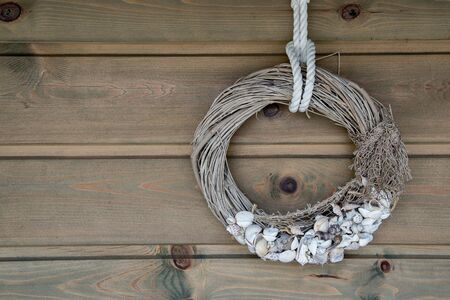 Wooden wall decoration with Sea thematic frame, decorated with seashells. Marine themes in hand work for interior decoration. 版權商用圖片