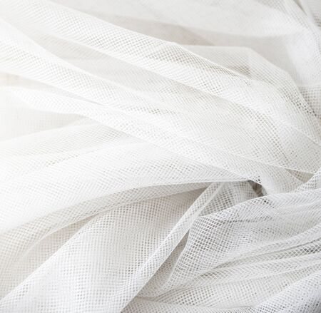 Wedding White Silk transparent fabric. Abstract soft chiffon texture background. Soft white chiffon with curve and wave pattern.