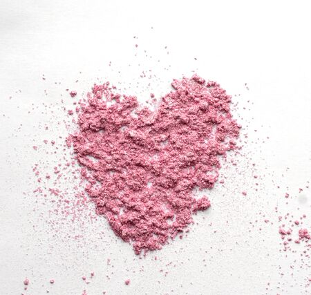 Pink Heart shaped from eye shadow and powder isolated on white background. Love Valentines day wedding card invitation concept.