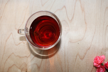 A cup of tea on a wooden background, the coziness of a new country house and a sunny bright morning