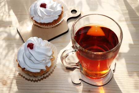 A cup of tea and cakes on a sunny table, diet food and a healthy lifestyle in the village, a beautiful morning in the village, a delicious dessert. Banco de Imagens