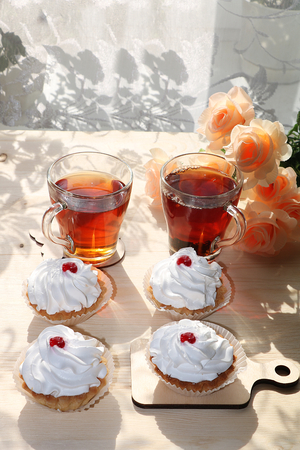A cup of tea and a cake on a sunny table, a bouquet of spring flowers for mood, diet food and a healthy lifestyle in the village, a beautiful morning in the village, a delicious dessert