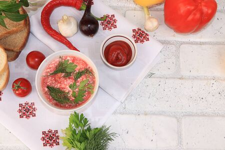 Traditional Russian borsch with egg and bread on a wooden table, place for text and menu, copy space. Delicious traditional natural food and cooking ingredients, healthy diet concept, top view, selective focus.