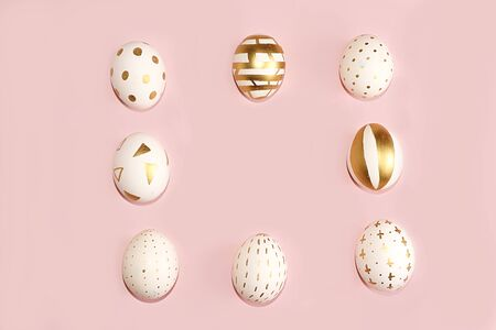 Decorated golden easter eggs on a pink background. Minimal holiday concept. Happy easter background. Creative painting of eggs at home, the idea of simple drawings for coloring, a place for text, a postcard, Foto de archivo - 140010571