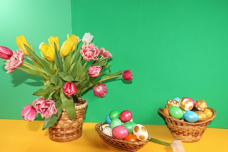 Decorated golden easter eggs on trendy green background. Minimal holiday concept. Happy Easter background, place for text, postcard,