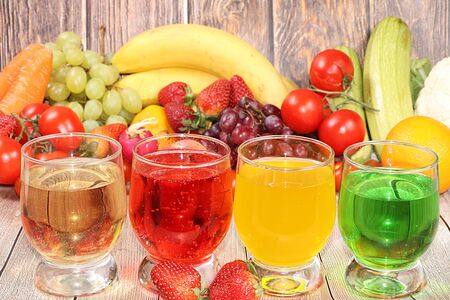 Citrus cider, juice, drinks and ingredients on a wooden table. The concept of detox diet and weight loss, healthy and natural foods. Summer drinks, vitamins C, immunity protection