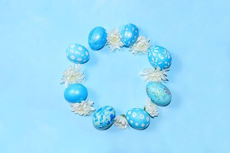 Decorated Easter eggs on a trendy blue background. Minimal holiday concept. Happy Easter background, greeting card, banner