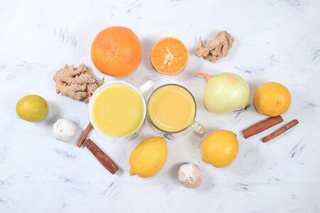 Latte with golden turmeric with ginger root, cinnamon, turmeric, lemon, spices for Ayurvedic medicine. The concept of alternative medicine, a means to increase immunity Foto de archivo