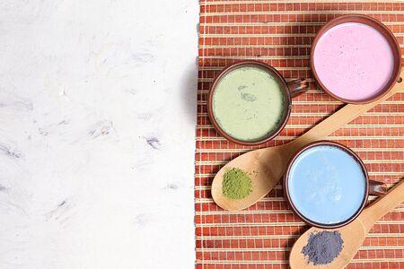 An assortment of colorful latte Japanese tea, golden turmeric, matcha, blue, pink moon milk. It has anti-inflammatory properties, improves immunity, Foto de archivo