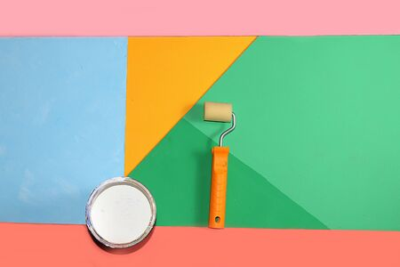 Repair tools on a multi-colored painted background. Shop banner, geometry. Minimal renovation and construction concept. Top view, . Trendy green, blue, pink color. Foto de archivo