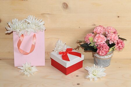 Flowers in a pink box, abstract spring floral background. Creative modern bouquet, minimal holiday concept. Greeting card for Women's Day or Mother's Day,