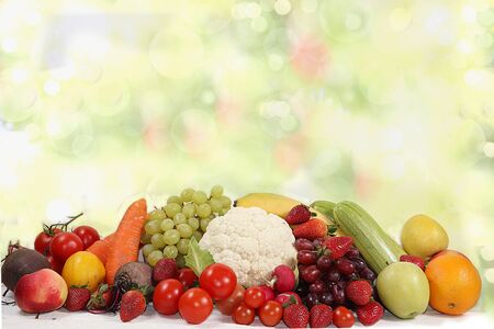 Vegetables, fruits on a bright background. The concept of healthy and natural foods to enhance immunity, healthy lifestyles, vitamins, detox diet. Summer banner,
