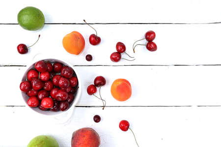 Healthy breakfast with ingredients, summer fruits and berries with grapes, cherries and peaches on a bright table. The concept of a healthy and natural diet, lifestyle