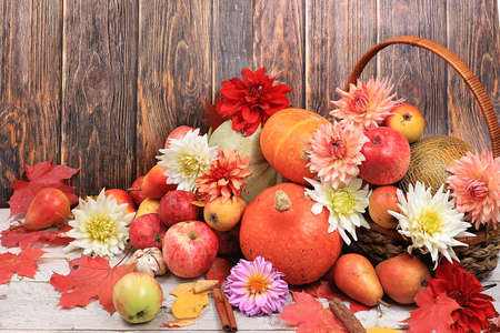Happy Thanksgiving concept, postcard Autumn background with seasonal pears, pumpkins, apples and flowers on wooden background, copy space, selective focus. Harvesting,