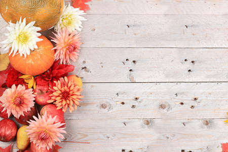 Happy Thanksgiving concept, postcard. Autumn background with seasonal pears, pumpkins, apples and flowers on wooden background, copy space, selective focus. Harvesting Stock Photo
