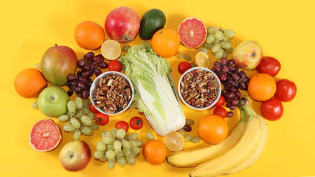 Tropical fruits, grapefruit, pineapple, grapes, granola, banner. Detox diet minimal concept. Space for text, flat lay. Healthy and natural food concept. Vitamins C,