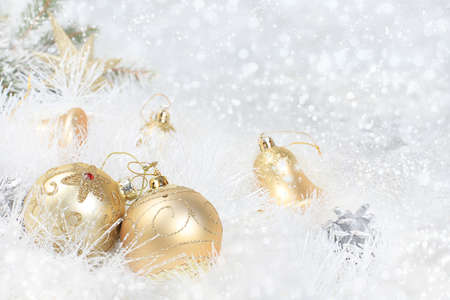 Christmas and New Year background with bokeh lights and decorations, toys with fir branches in snow flakes, place for text. Holiday card, selective focus, 版權商用圖片