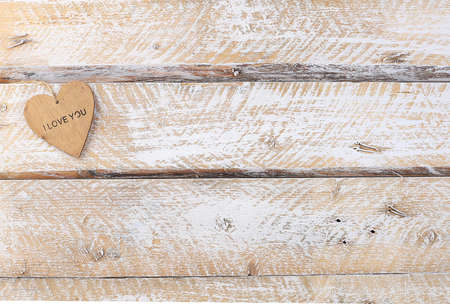 Heart on a wooden table, abstract festive background. Postcard for womens day or mothers day, happy birthday, wedding, valentine's day concept, banner for screen,