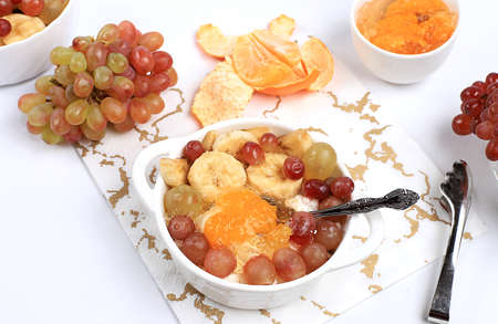 Fruit Salad With Grapes Tangerines Banana And Jam For Weight Stock Photo Picture And Royalty Free Image Image 162189315