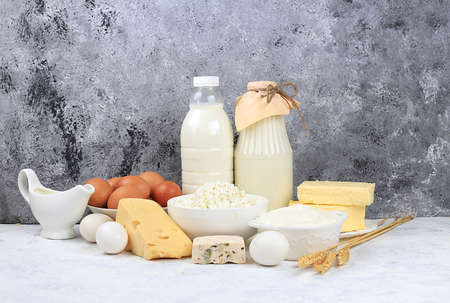 Assorted fresh dairy products, healthy breakfast with ingredients, natural nutrition concept, maintaining healthy intestinal microflora, diet nutrition, rustic table, selective approach Фото со стока