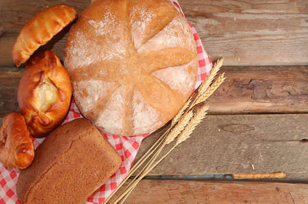 Homemade pies with toppings, bread on an old wooden table, healthy and natural food concept, Traditional rustic Russian style, top view, bakery business card,