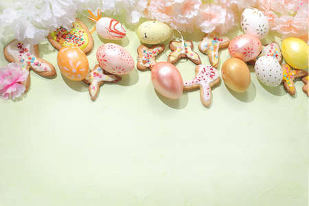 Happy Easter concept, spring card, composition with flowers, cookies and eggs on a gentle background. Festive minimal concept, home baking ideas, place for text, banner for screen, selective focus