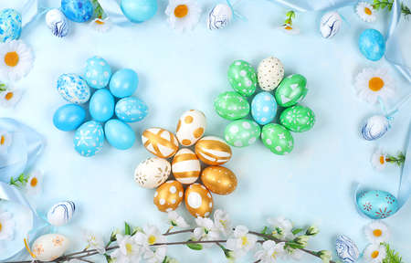 Easter composition with decorated eggs and flowering branches, abstract spring card, happy holiday concept, background, banner for screen,