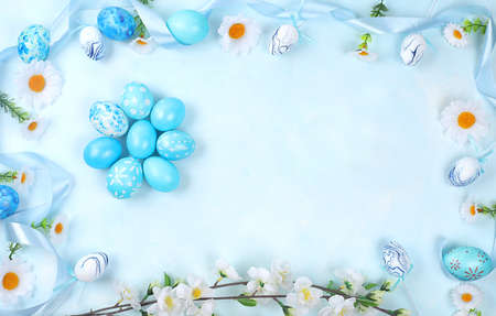 Decorated blue Easter eggs on a blue background. Minimal holiday concept. Happy easter background. Creative painting of eggs, idea of simple drawings for coloring, postcard, banner for screen, selective focus