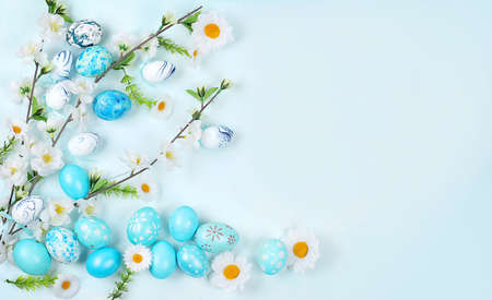 Easter composition with decorated eggs and flowering branches, abstract spring card, happy holiday concept, background, banner for screen, selective focus