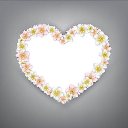 Plumeria (frangipani) flowers over white paper heart.