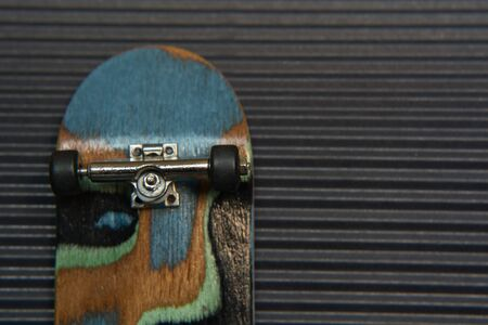 corrugation: Front view of the back of a skate board with black wheels