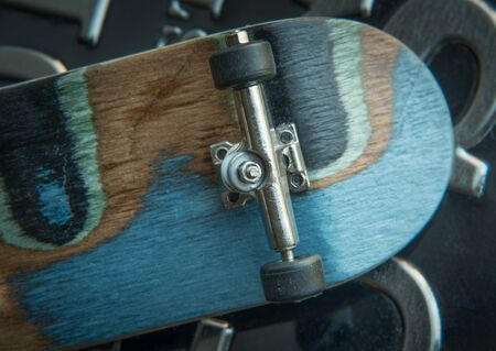skate board: Front view of the back of a skate board with black wheels