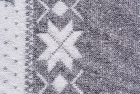 weaved: Knitted pattern with white snowflakes
