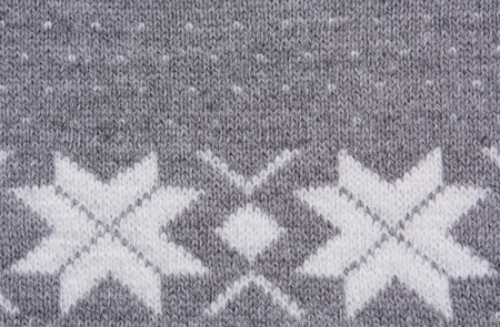 ashy: Knitted pattern with white snowflakes