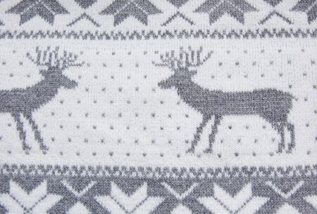 weaved: Knitted pattern with grey deer