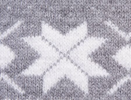 knitted: Knitted pattern with white snowflakes