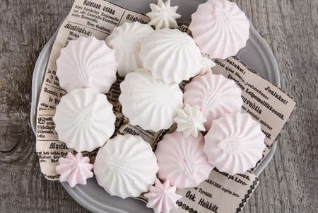 pastila: White and pink marshmallows on vintage paper in dish. Top view. Stock Photo