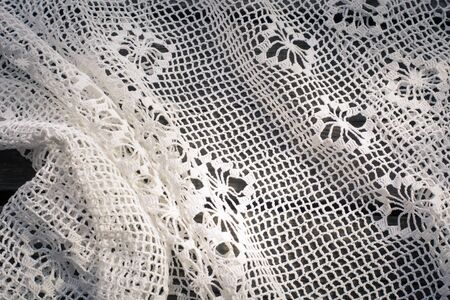 scrapbook homemade: Crochet  white lace on wooden board Stock Photo