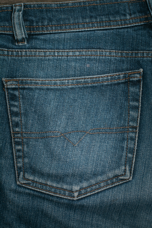 jeans pocket: Blue jeans back pocket wooden board. Background. Stock Photo