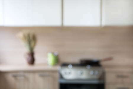 Blurred background. Modern kitchen with bokeh light. Stok Fotoğraf