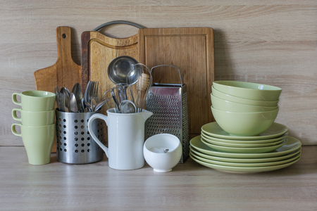 tableware life: Kitchen still life as background for design. Crockery, tableware and other different stuff on wooden table-top. Image with copy space.