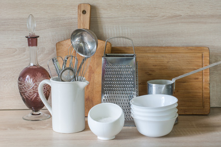 tableware life: Crockery, tableware, utensils and other different stuff on wooden table-top.Kitchen still life as background for design.  Image with copy space. Stock Photo