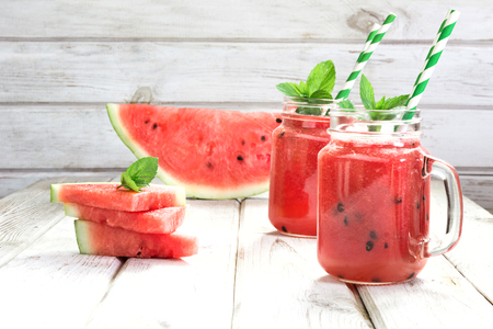 Summer refreshing detox smoothie of watermelon and mint on a white wooden background. Stock fotó