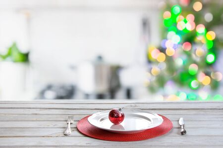 Christmas table background with christmas tree in kitchen out of focus. Background for display or montage your products.