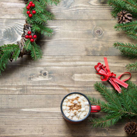 Christmas composition of wreath, hot chocolate on wooden board. Flat lay. Top view. Copy space. Stock Photo