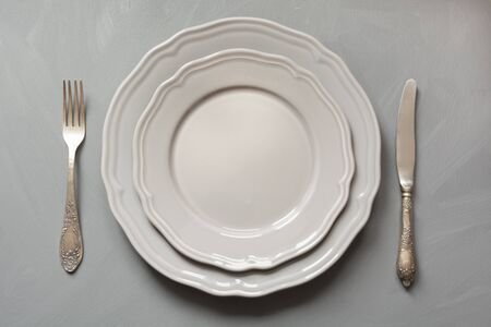 Table place setting on gray. Top view. Concept. Minimalism Standard-Bild