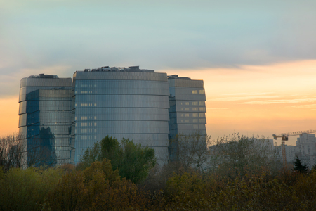 Amazing view of an office high-rise building of glass on a sunset.